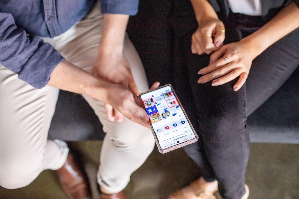People holding phone for social media Instagram